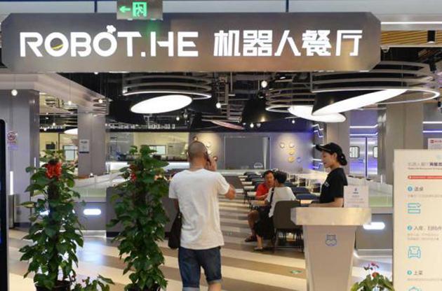 (Foto) Robots mesoneros causan sensación en un restaurante chino